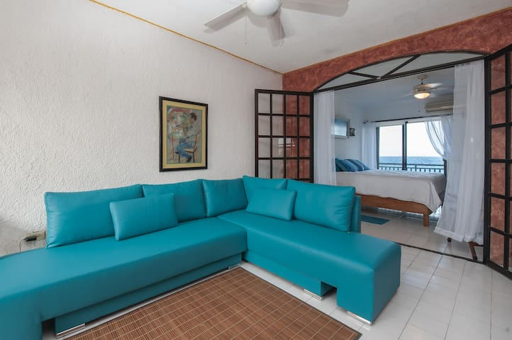 Sofa bed for one extra guest, cushions swivel to form large twin