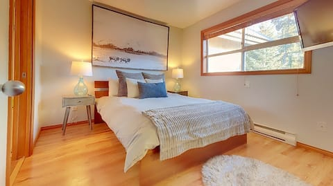 Curl up on the comfy bed and watch some TV.. or the mountain views!