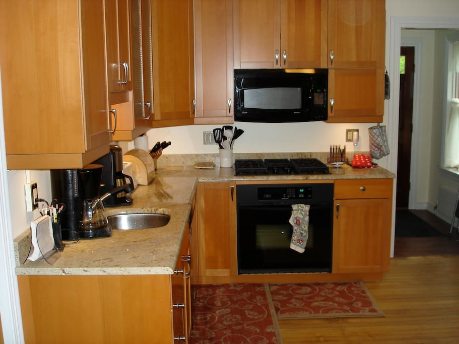 Kitchen w/ microwave and D/W.