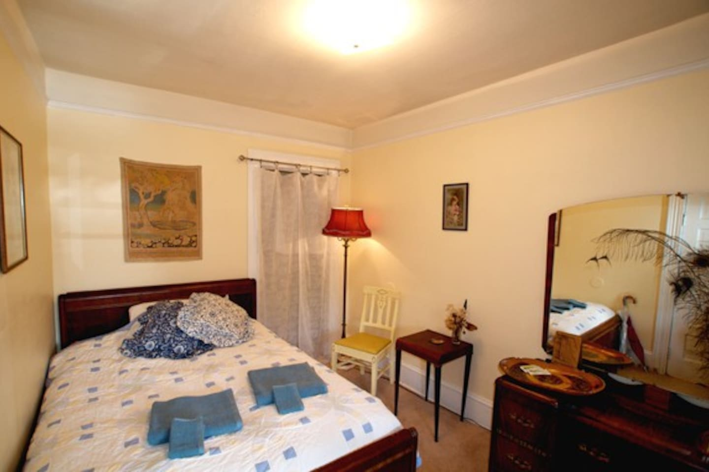 guest bedroom with full size bed and down matress cover                      guest bedroom with down mattress cover....