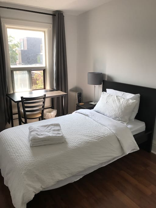 Twin bed with white linens