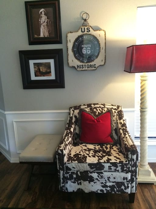 Faux cowhide chairs with memory foam and ottomans.