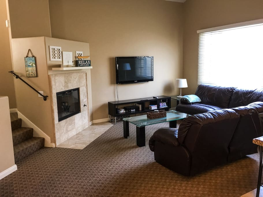 Living area, flat screen tv, Nintendo wii, gas fire place, over size couches that both recline