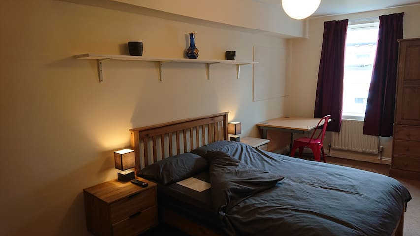 """The master bedroom features a double bed, Dunelm """"Blackout Curtains"""", wardrobe, drawers, desk and a Smart TV."""