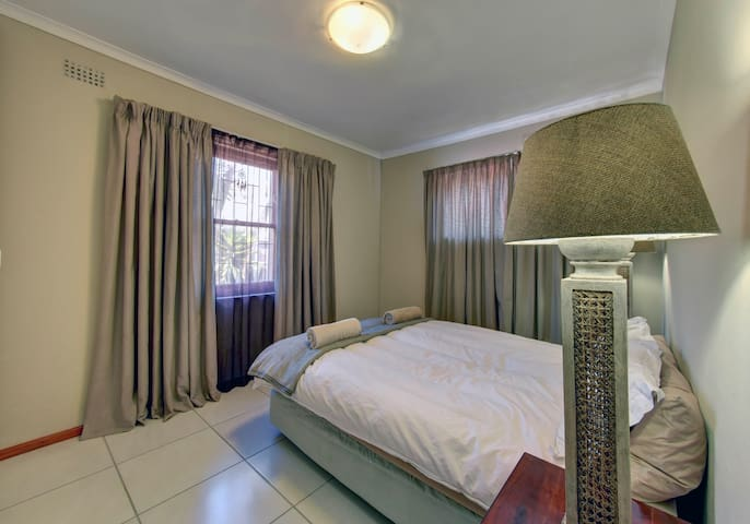 Comfortable main bedroom with queen size bed and 100% cotton linen and built in cupboards