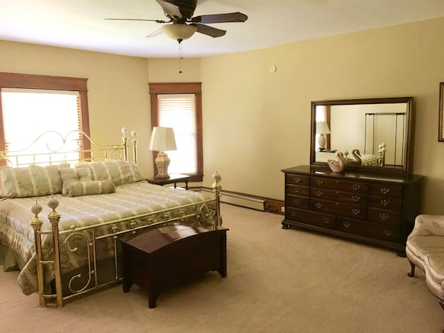 The second attached bedroom has a king size mattress and lots of space.