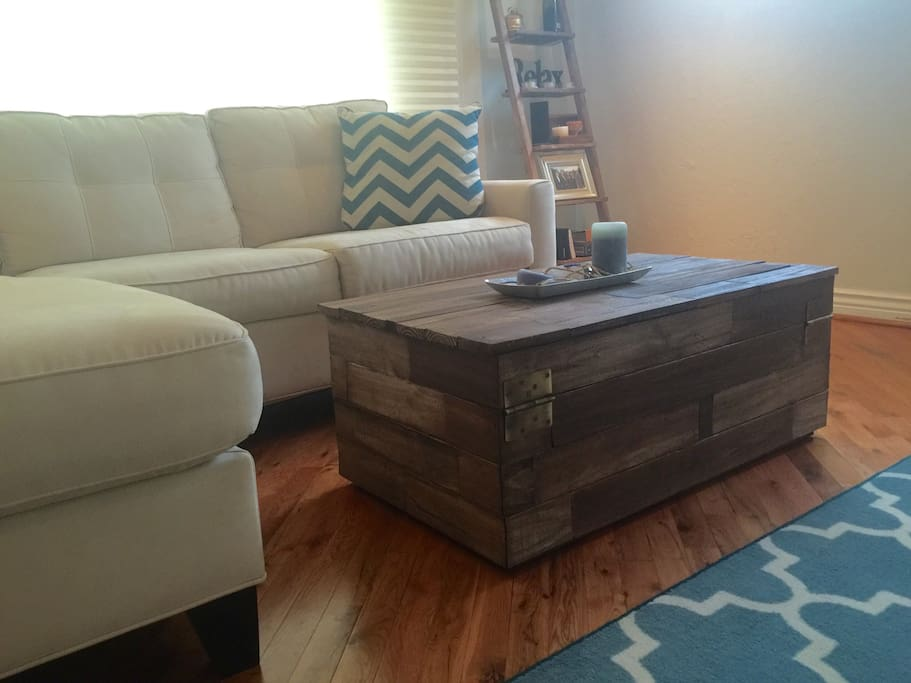 Coffee table, end table, ladder shelves and entertainment center are all custom hand-built reclaimed wood pieces built right here in Delray!