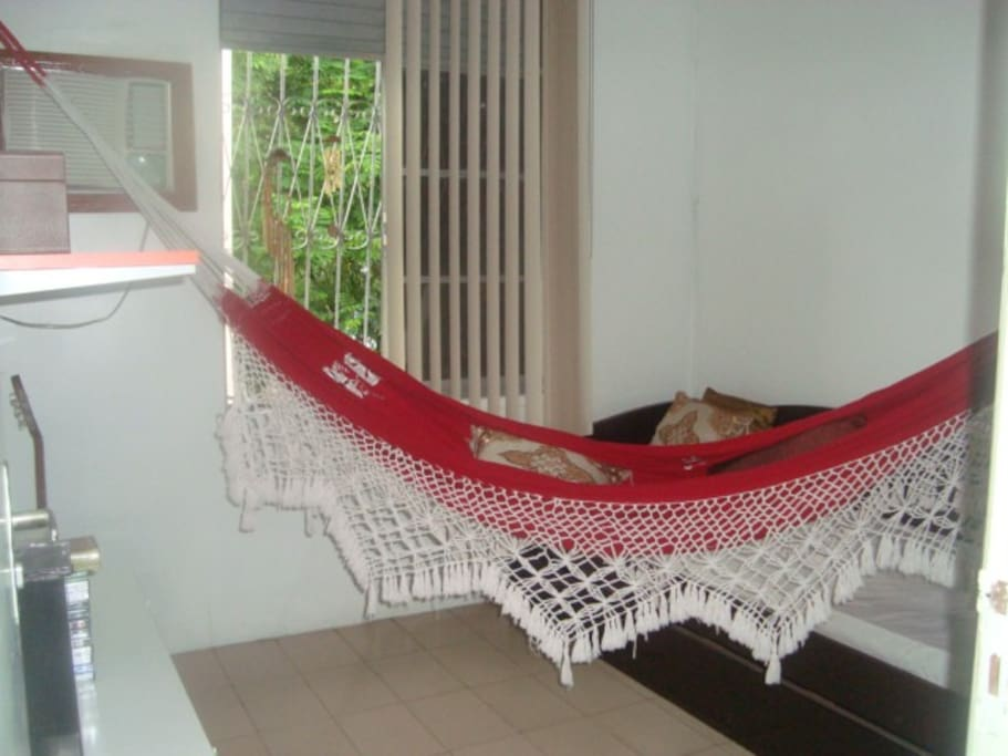 Bedroom with 2 beds, hammock and air conditionaing