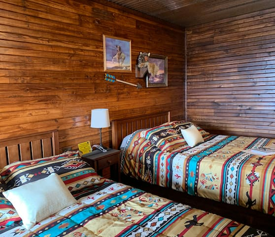 Two comfy queen beds in The Chief Cabin at The  Lazy Buffalo, Cache, OK