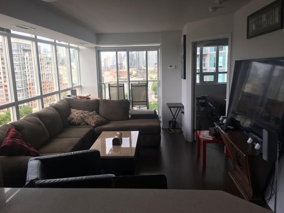Large living area with sectional couch and 72 inch tv