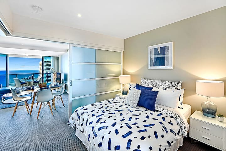 A beautifully designed bedroom with high-quality linens and interior to the highest standard.