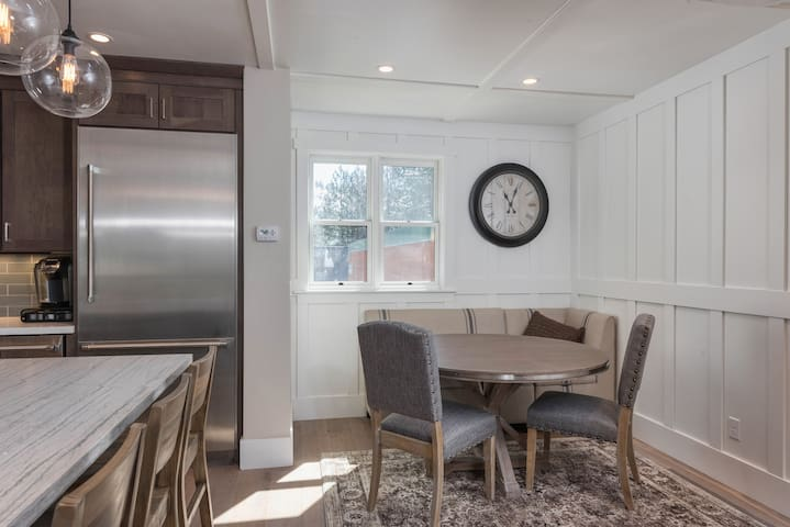 Have breakfast in the dining nook with 2 chairs and a cushioned bench for 3.