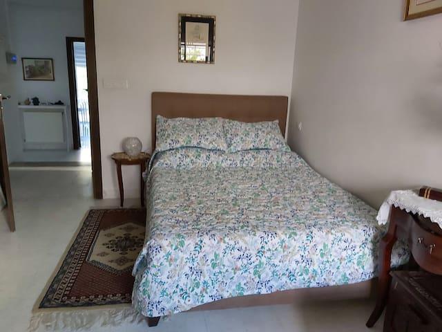 A warm private room in Lily's Cosy Casa.