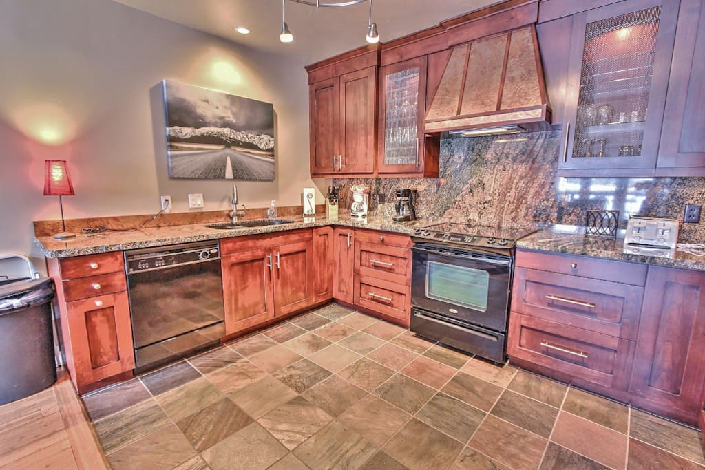 Kitchen with granite counter tops and new appliances in Deer Valley Aspens - Deer Valley