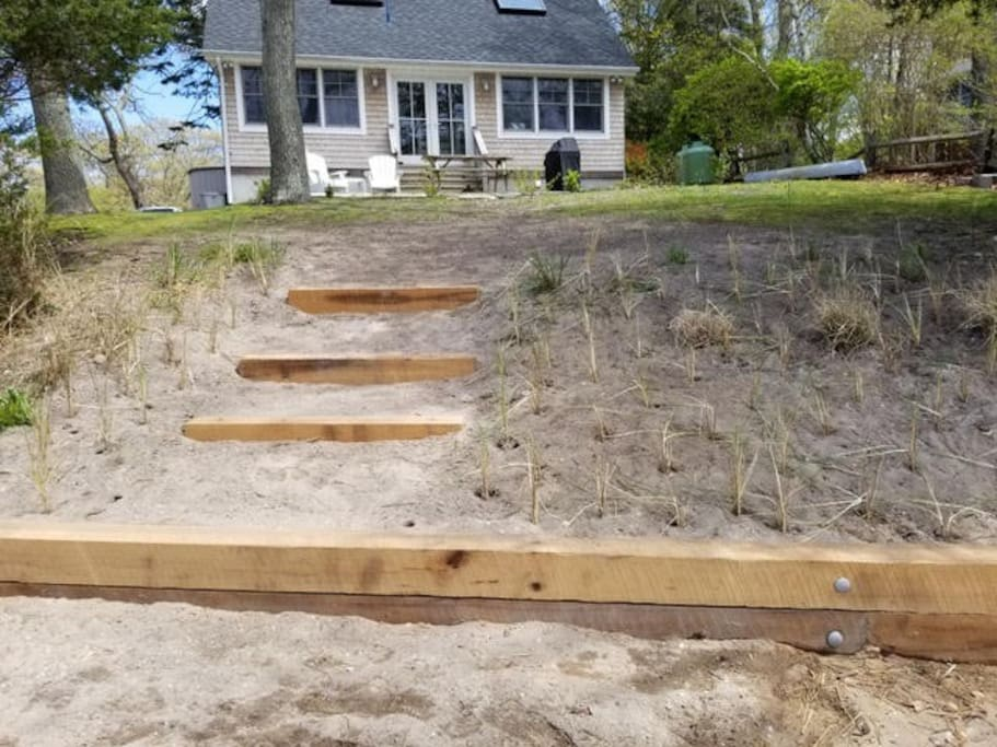 Three steps down to the private beachfront.