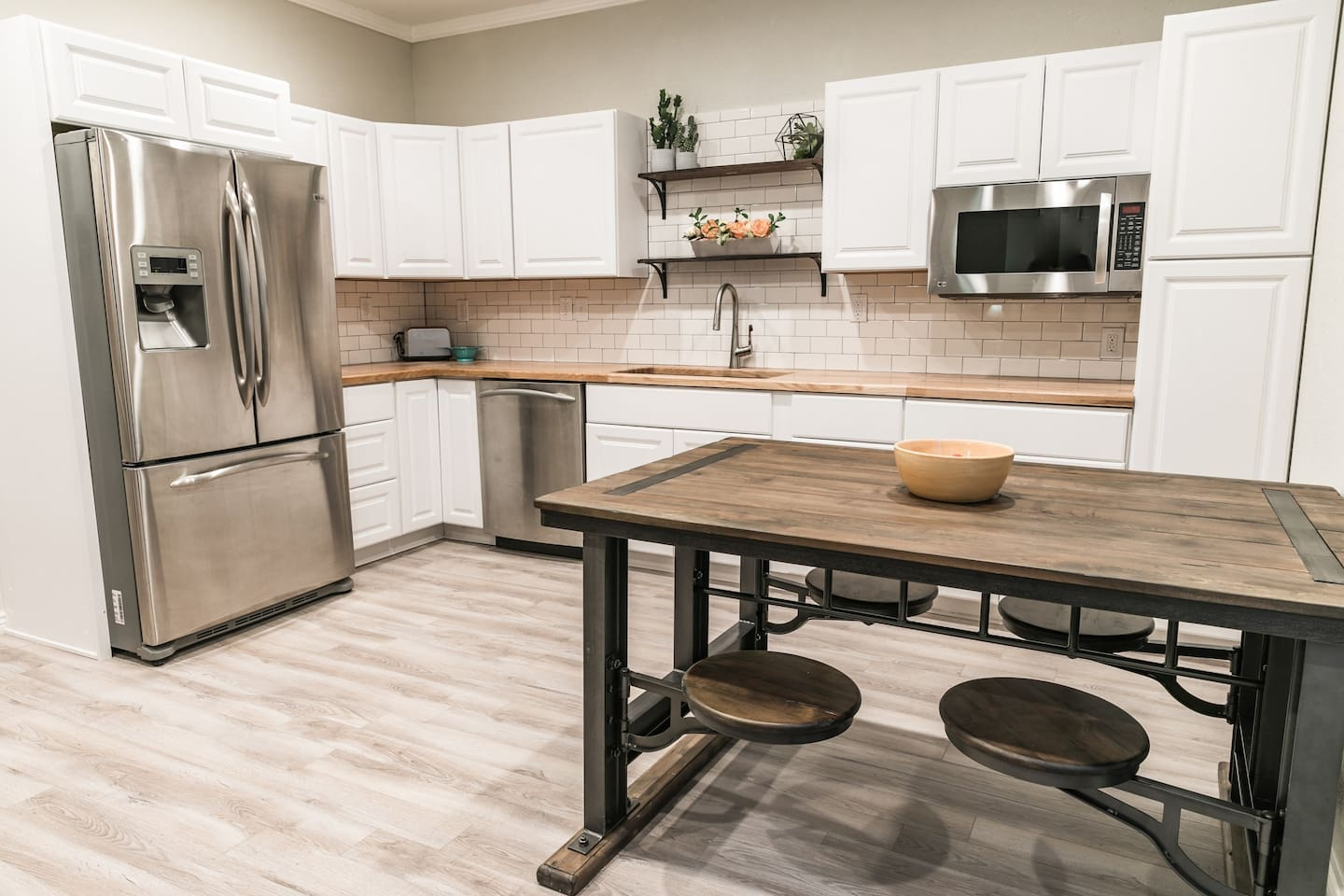 Stainless steel appliances and white subway tile keep this space bright and fun.