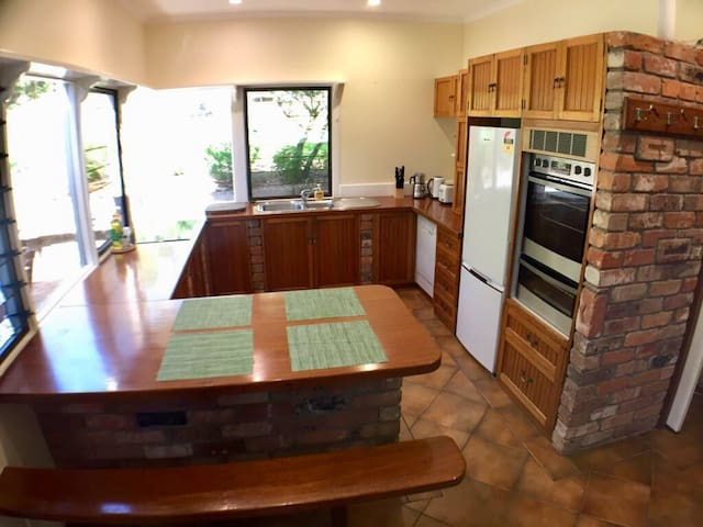 Large kitchen with breakfast bench