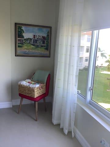 Master Bedroom overlooking the ocean and pools