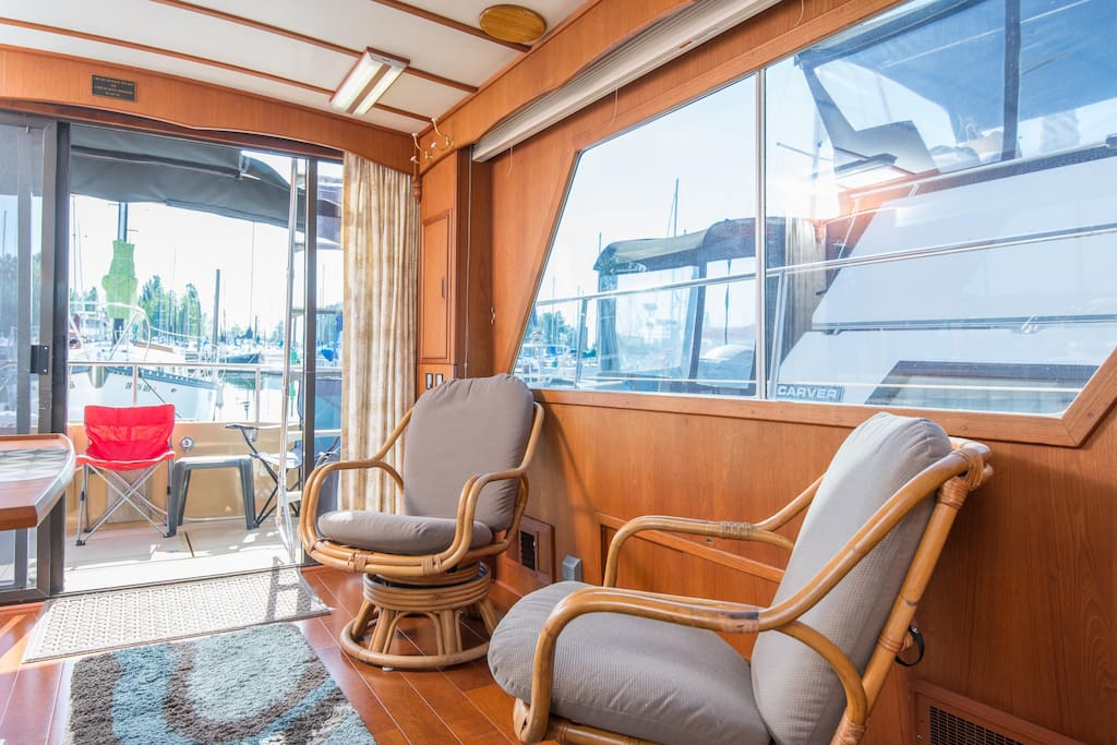 The salon looking to port aft and sliding glass entry door.