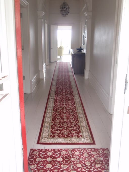 Wide spacious hallway  leading from the front door