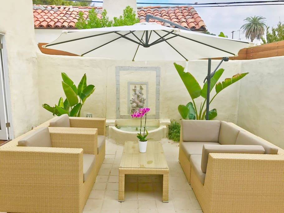 Nicely furnished Private Patio & Fully Restored Wall  Fountain. Please Note : Please close the umbrella on windy days . Thank you .