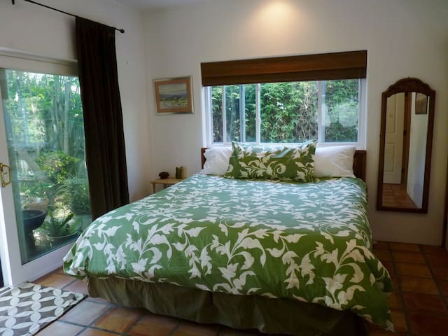bedroom with slider that opens to the backyard