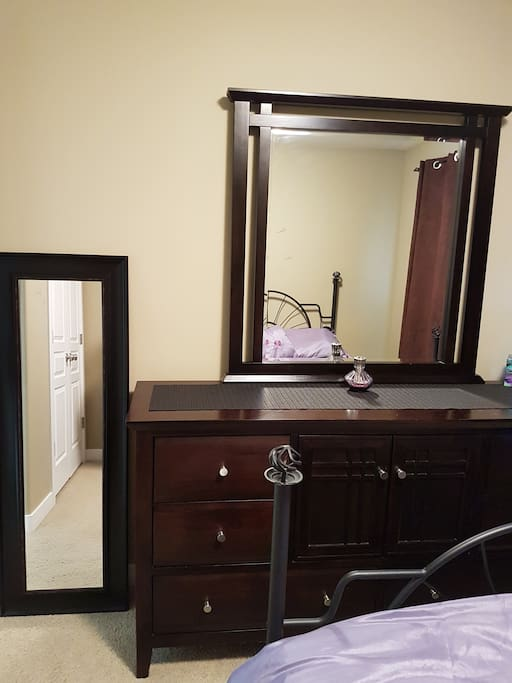 Full mirror and dresser in bedroom