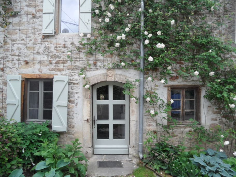 Arched entrance with climbing roses