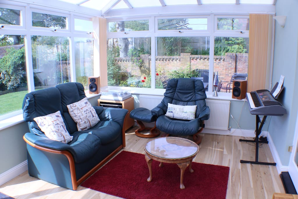 Our sunny conservatory is available for guests to relax in.