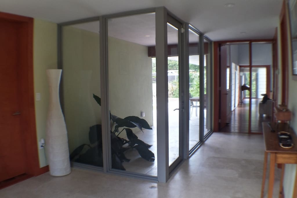 Foyer overlooking pool and lawn
