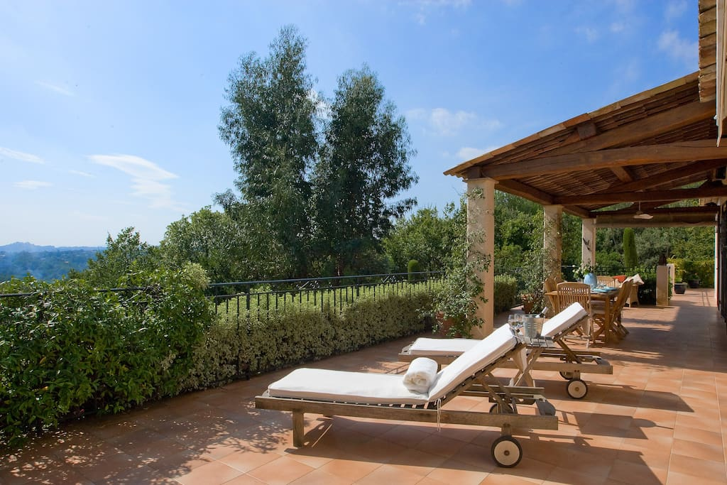 Fantastic terrace with views over garden and hills.