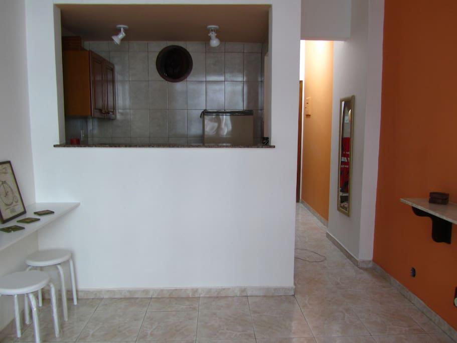 integrated kitchen with fridge, stove and microwave