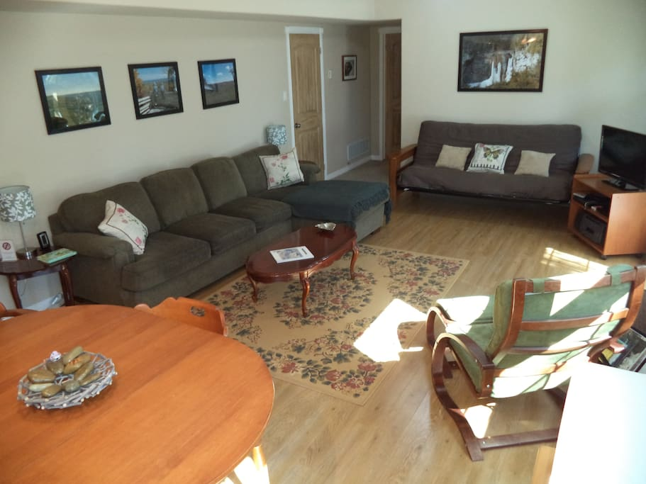 Spacious living area with walk out to private deck.  Has futon sleeper sofa to accommodate more guests.