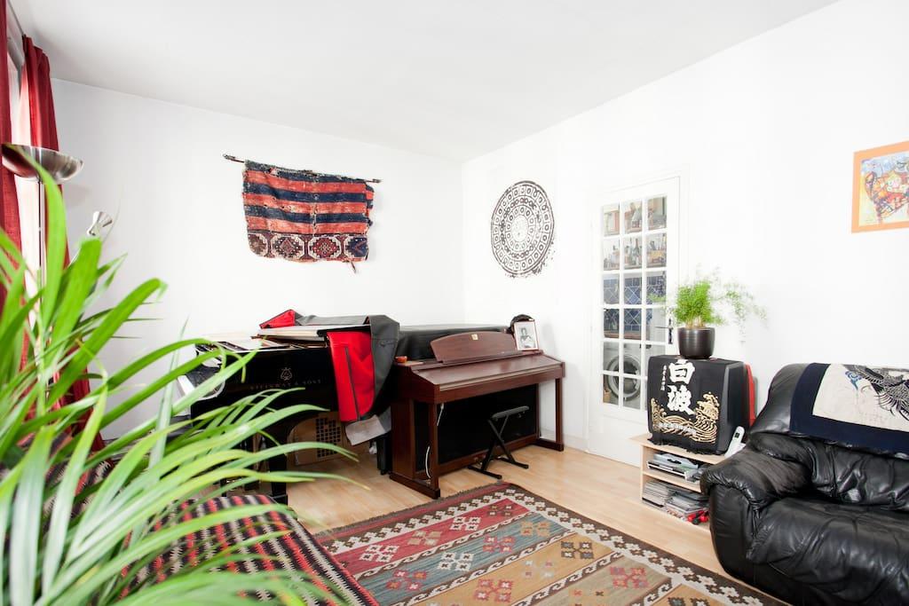 The living room, with kitchen door.