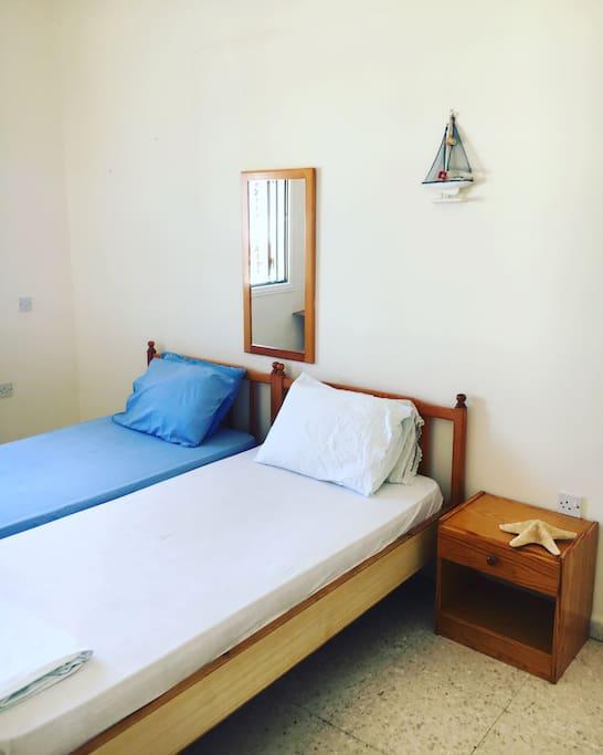 Spacious bedroom 2 single beds