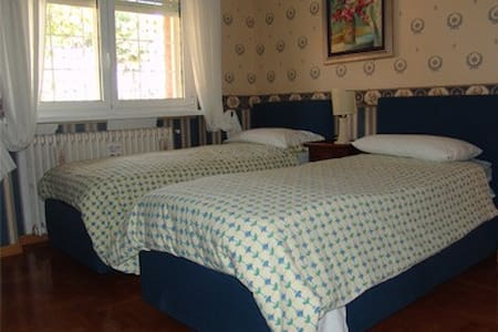 Winter room is a beautiful room with the lovely blue tones and offers to its guest an enchanting view over our rock garden.It's a double twin beds with shared bathroom on the same floor and very close to the room.