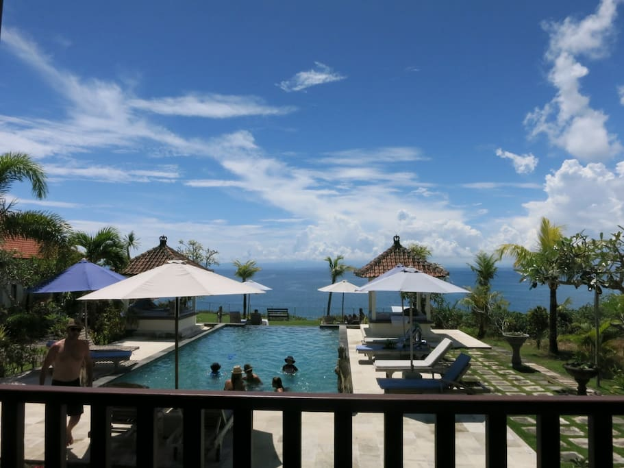 This is the view looking across our pool.  This is a beautiful day with big clouds.