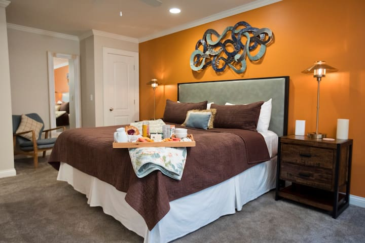 Luxurious linens, king size bed, and space await in your private retreat