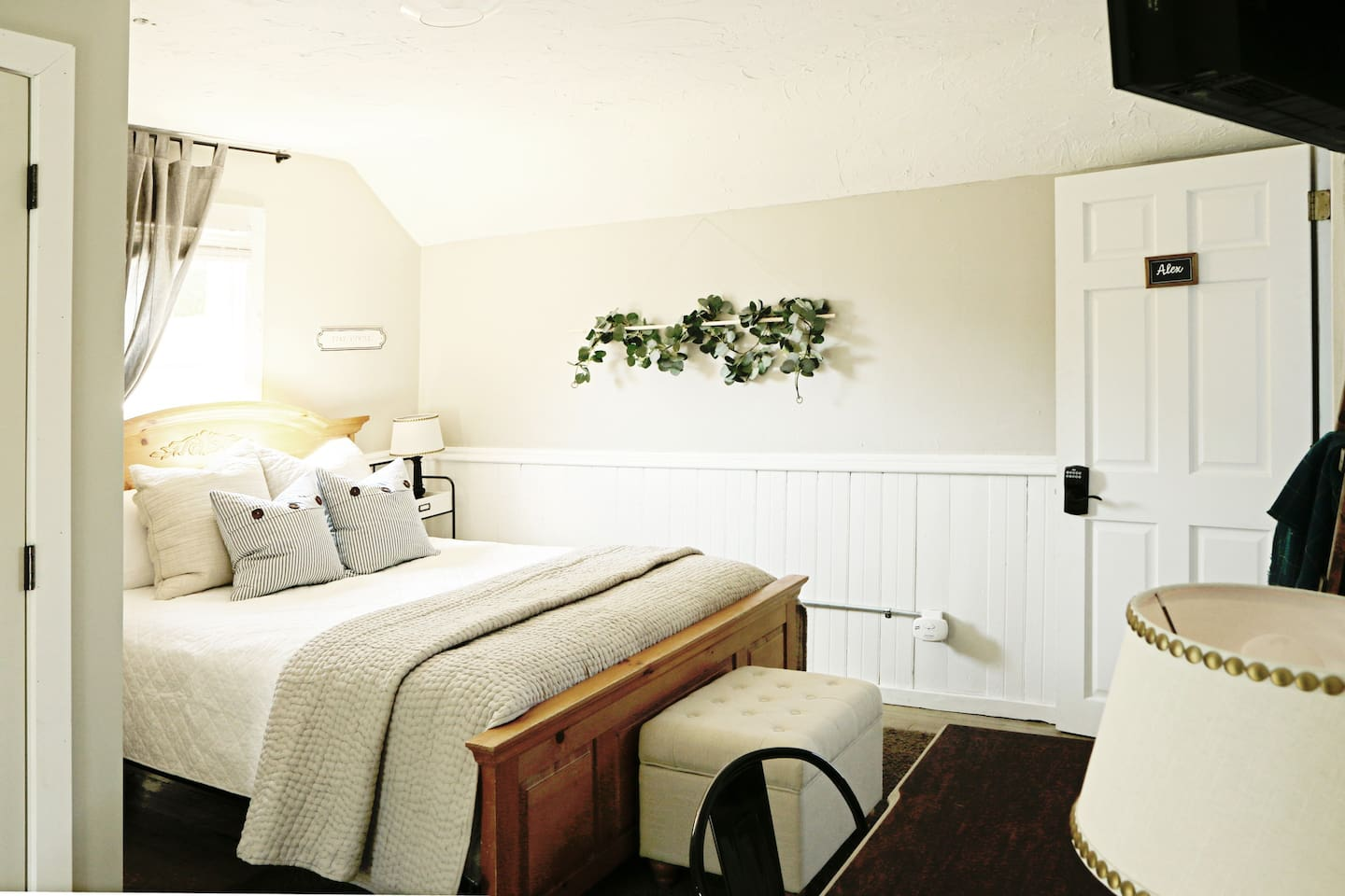 """""""Alex"""" features a queen bed with high-quality mattress and linens."""