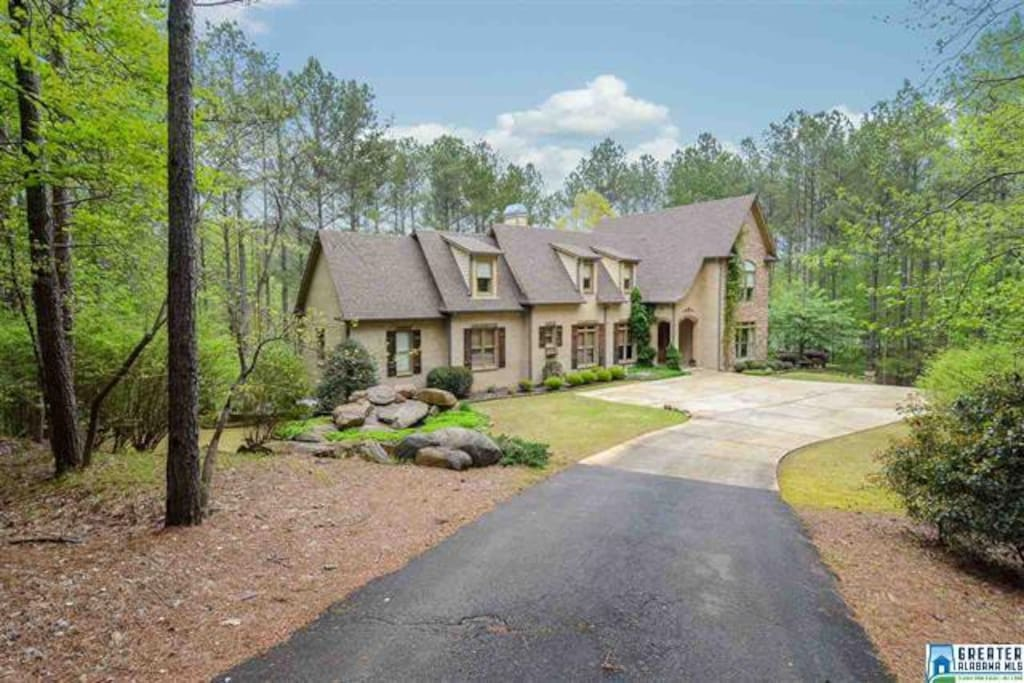 On 4 wooded acres overlooking lake
