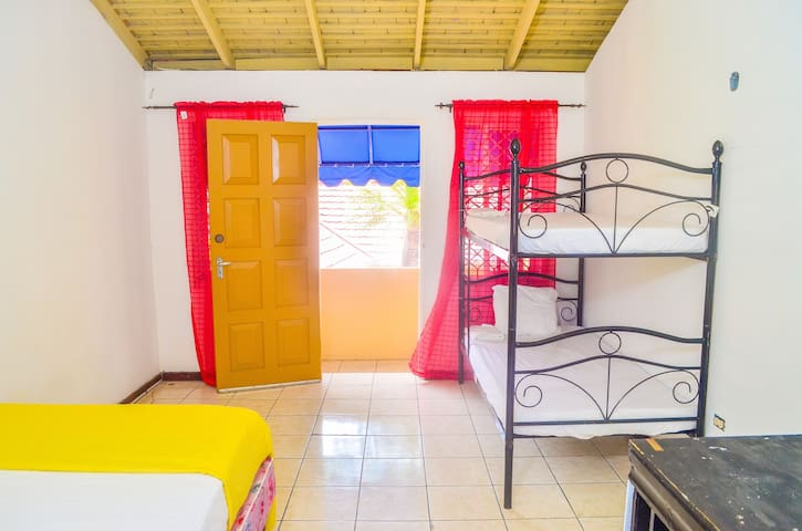 The room has a single bed and a bunk bed which makes it perfect for couples or small groups of three people. There is no A/C but the room is cool enough with great cross ventilation.