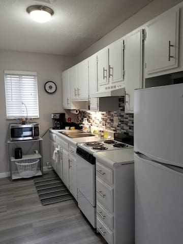 Full kitchen with stove/oven, microwave, refrigerator, toaster, coffee station and all essential kitchenware.