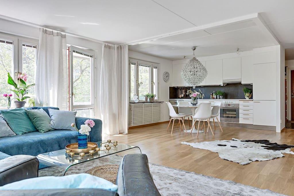 Livingroom facing towards kitchen and balcony.