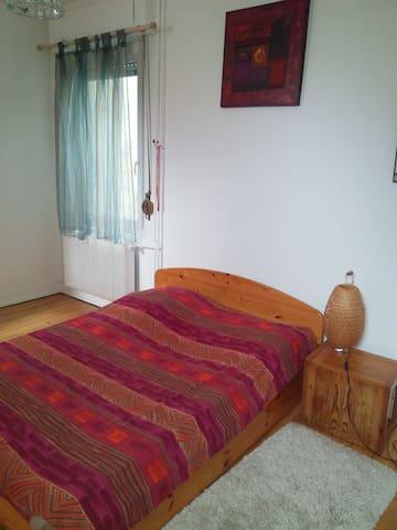 Grande chambre dans appartement calme et cosy