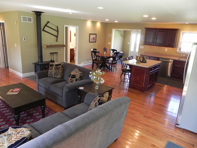Open design living room flows into kitchen and dining. Blueray DVD, streaming video and Vermont casting woodstove.