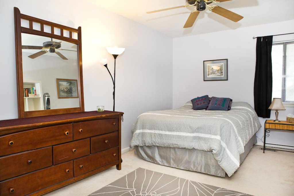 The room includes a desk and lamp to do work from home if desired.