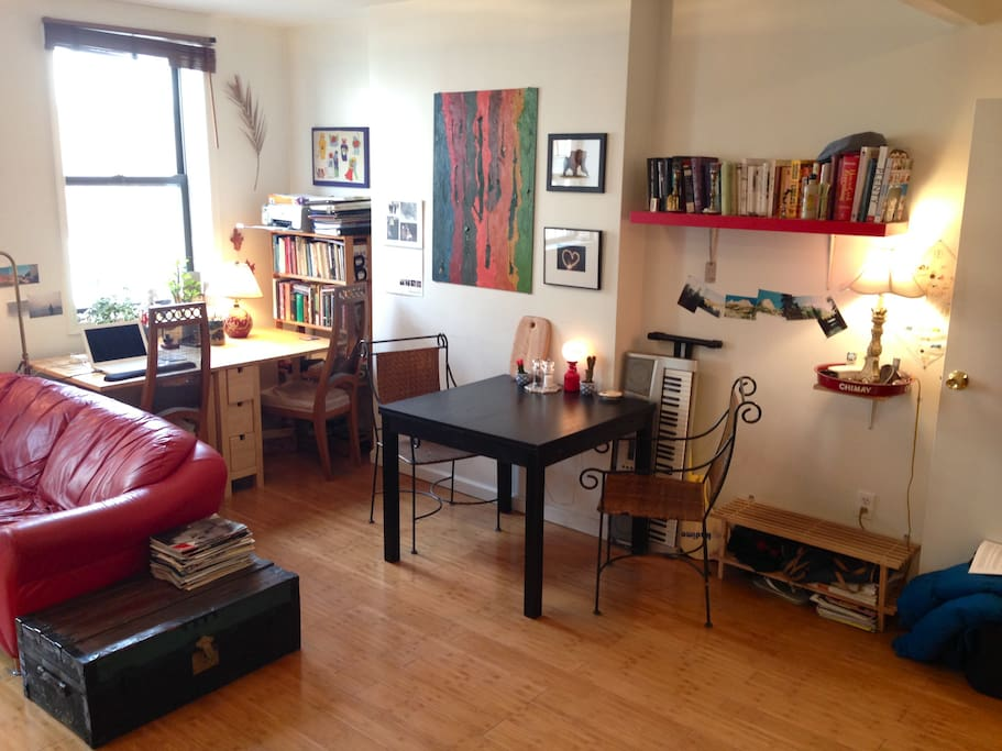 Main Room 2 -- original artwork, dining table with extensions (can seat up to 5), desk space for 2, printer, keyboard, cookbooks,