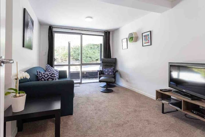 Separate lounge room with sofabed and freeview TV