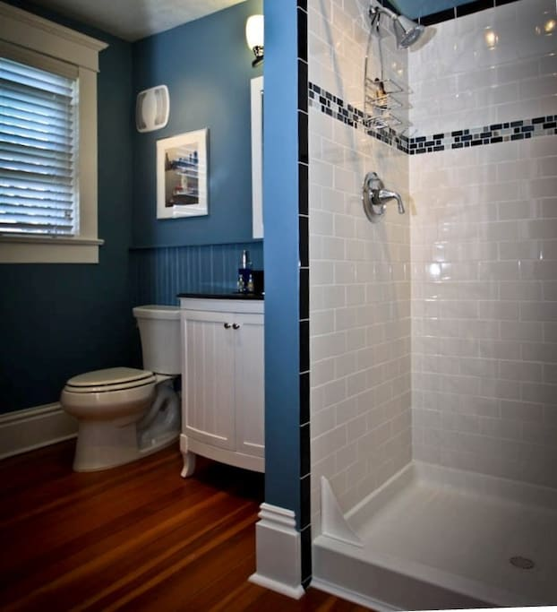 A private attached bath with subway-tiled shower. We feature fine 1888 Mills all-cotton towels and fine soap/shampoo products.