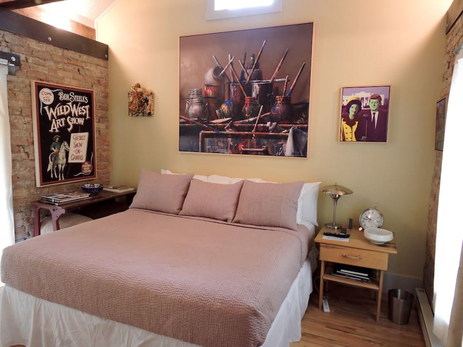 Kingsize bed and original artwork throughout